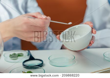 Biologist With Petri Dishes