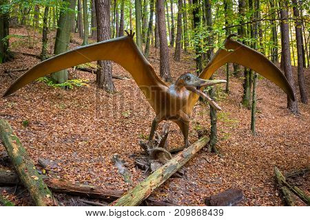 GDANSK, POLAND - OCTOBER 18, 2017: Realistic dinosaur model in Jurassic Park of Gdansk Oliwa. Dinosaur Park located at the zoo in Gdansk exihibits numerous natural size dinosaurs models.