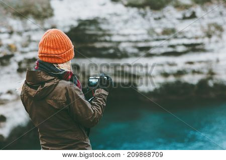 Woman traveling at cold sea with photo camera Travel Lifestyle concept adventure vacations outdoor