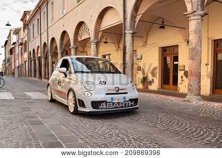 MELDOLA, FC, ITALY - OCTOBER 10: driver and passenger on a small Italian sports car Fiat 500 Abarth esseesse in car rally