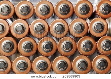 AA alkaline batteries in rows seen from above