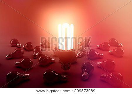 Digital composite image of illuminated energy efficient lightbulb over bulbs on gray background