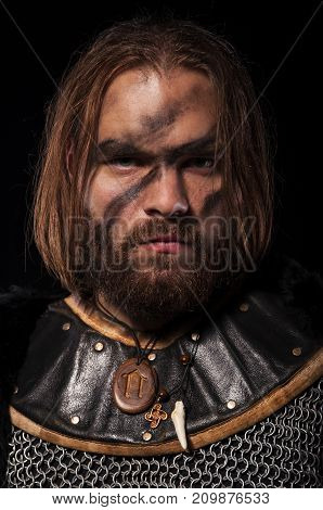 Formidable Viking In Chain Armor On The Black Background