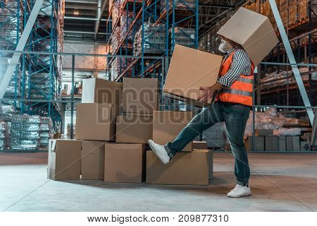 Warehouse Worker With Boxes