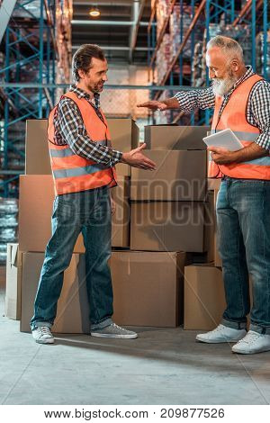 Warehouse Workers With Digital Tablet