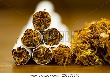 cigarette and tobacco on wooden texture close up composition photography