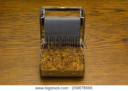 tobacco and tobacco box on wooden background close up photography