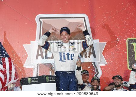 October 15, 2017 - Talladega, Alabama, USA: Brad Keselowski (2) takes the checkered flag and wins the Alabama 500 at Talladega Superspeedway in Talladega, Alabama.