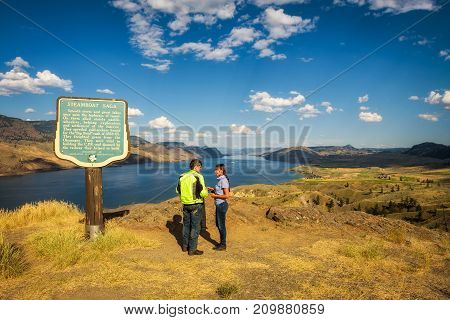 KAMLOOPS LAKE, BRITISH COLUMBIA, CANADA - JULY 2, 2017 : Visitors standing at the Kamloops lake  situated on the Thompson River along the Trans Canada Highway.