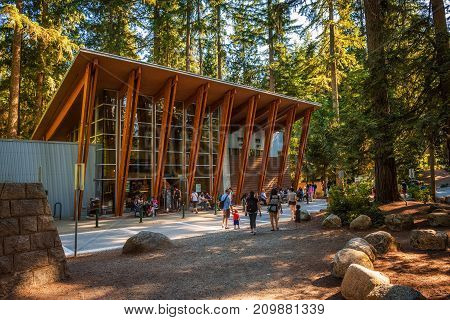 LYNN CANYON PARK, CANADA - JULY 3, 2017 : Tourists and visitors in and around the Lynn Canyon Cafe situated in the Lynn Canyon Park near Vancouver.
