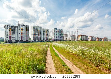 Construction of new houses near a glade in sunny day