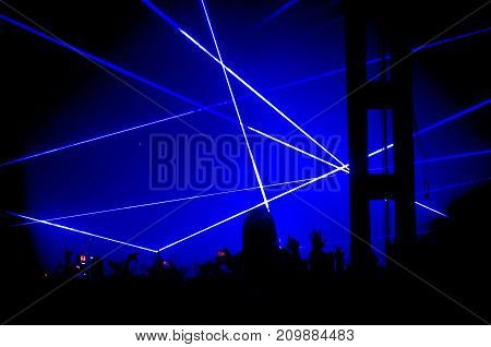 different colors of light at a light show at a concert.