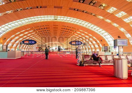 Paris, France, April 1 2017: Unidentified people at the hall of departure in the terminal of Roissy Charles de Gaulle International Airport, Paris, France, is a hub for the French airline Air France