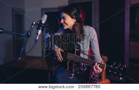 Professional Musician Recording In Studio