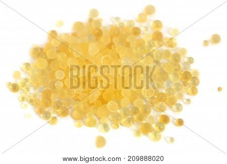 Silica gel used as water absorbent over white background