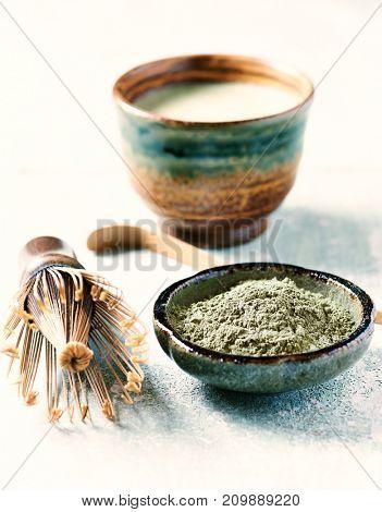 Organic matcha tea and a bamboo tea whisk