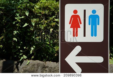 Signboard of the public toilet of the outdoor park