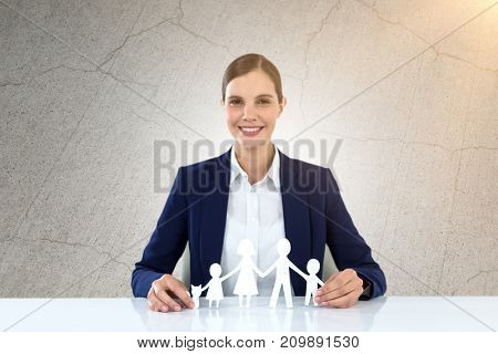 family in white paper with a woman in the background against gray cracked concrete wall