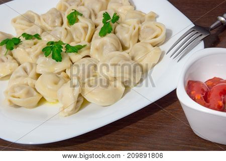 Italian ravioli with tomato sauce and fresh parsley