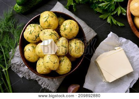 Natural food. Tasty new boiled potatoes with dill in bowl top view.
