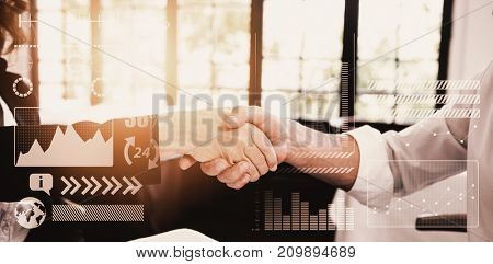 Light with a white background against business partners shaking hands in meeting
