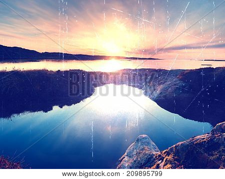 Concept Of Seascape Sunset Or Sunrise Background With Rich Reflection In Water Pool. The Sun Is Hang