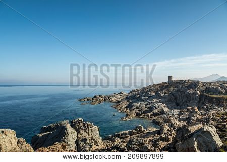Rocky Coastline And Genoese Tower At Punta Spano In Corsica