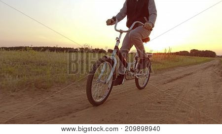 Boy teenager riding a bicycle. Boy teenager riding a bicycle goes to nature along path steadicam shot motion video