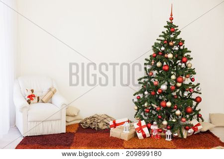 Christmas tree on new year's Eve in a white room with Christmas gifts 1