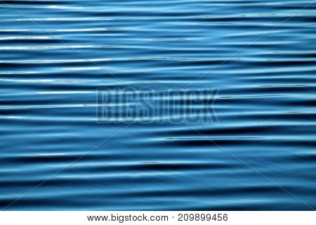 Abstract water background with waves in the form of long parallel lines