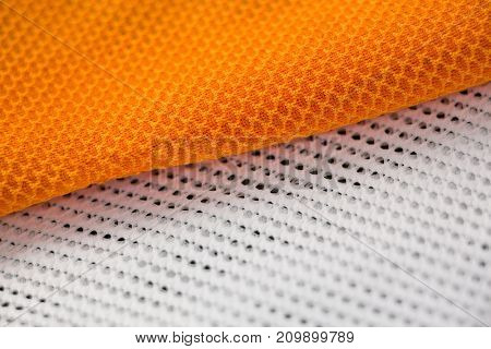 Close-up of white and orange textile