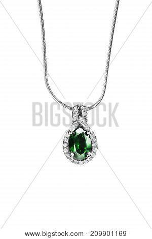 Emerald pendant with diamonds hanging on silver chain on white background