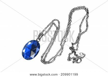 Blue sapphire faceted pendant on silver chain isolated over white