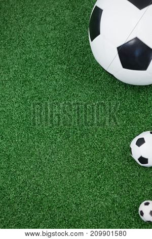 Close-up of various size of footballs on artificial grass