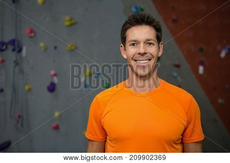 Close up portrait of smiling male athlete standing in club