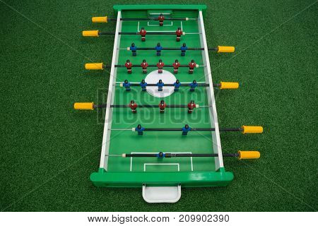 Table soccer game arranged on artificial grass