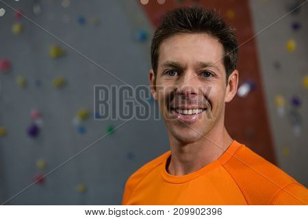 Close up portrait of confident athlete standing in club