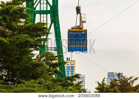 The cableway over the city on the background of the sea in sunny day Sochi Russia