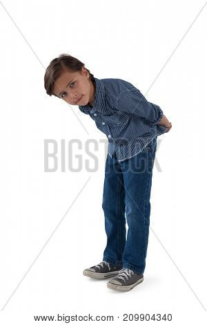 Portrait of boy standing against white background