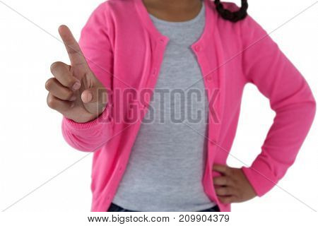 Mid-section of girl pretending to touch an invisible screen against white background