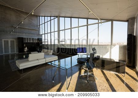 Interior of empty creative office during sunny day