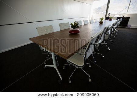 High angle view of conference table in empty meeting room