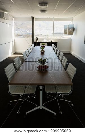 Interior of modern meeting room at empty creative office