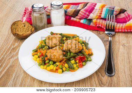 Plate With Vegetable Mix And Meatballs, Napkin, Salt, Pepper, Bread