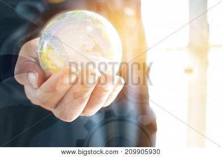 Businessman holding Earth globe model ball map with Radar background in hands. Concept for global business communications politics environmental for learning world wide in online market.