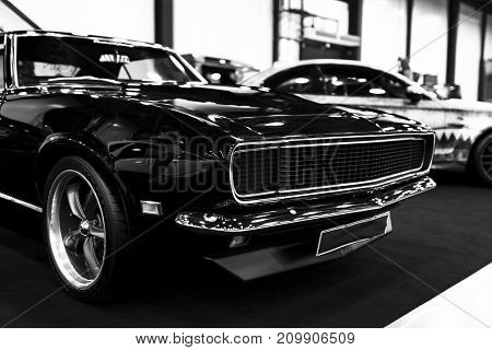 Sankt-Petersburg Russia July 21 2017: Front view of a Black Dodge Charger R\T muscle car. Car exterior details. Black and white. Photo Taken at Royal Auto Show July 21