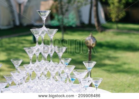 Champagne Glass Pyramid. Pyramid Of Glasses Of Wine, Champagne, Tower Of Champagne's Glass In Weddin