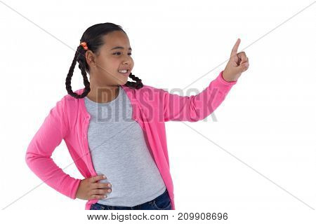 Girl pretending to touch an invisible screen against white background