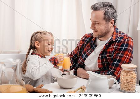 Father And Daughter Having Breakfast