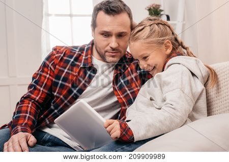 Father And Daughter With Digital Tablet